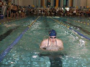 Swimming in a high school swim meet.